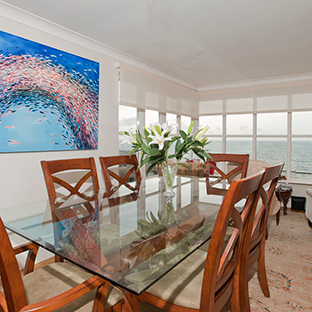 The dining room looks out onto the sea