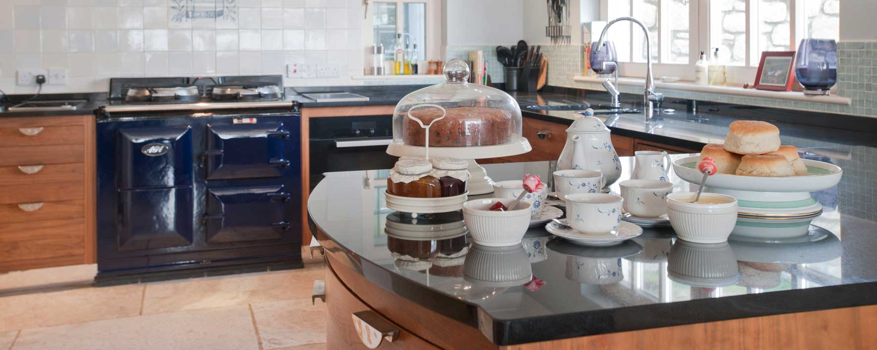 Well–appointed kitchen with cream tea on arrival